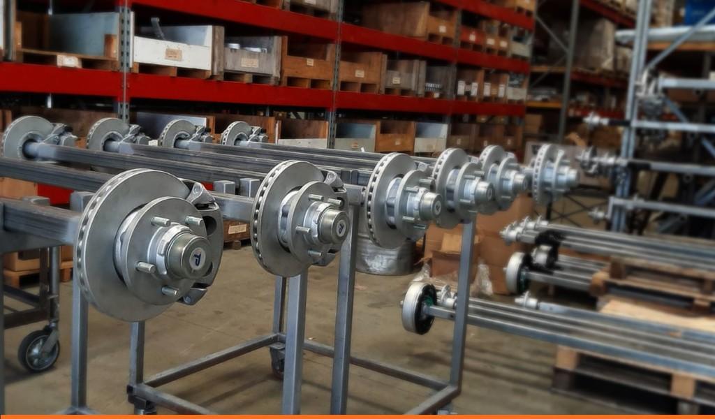 trailer axles with mounted trailer brake hubs